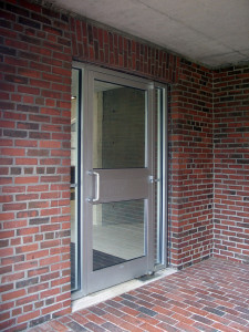 "Figure 10b: The understated ""hidden"" front entrance at one end of the arcade."